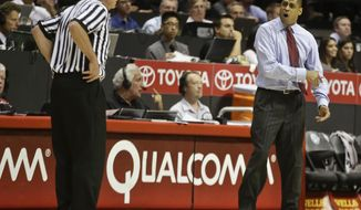Fresno State coach Rodney Terry protests an offensive goal tending call to referee Dave Hall during the second  half of a 68-60 victory by San Diego State in a NCAA college basketball game Wednesday, Jan. 15, 2014, in San Diego. (AP Photo/Lenny Ignelzi)