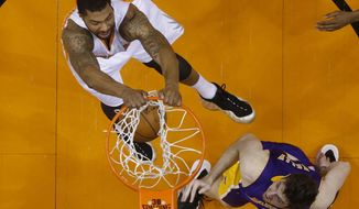 Phoenix Suns forward Markieff Morris dunks against Los Angeles Lakers forward Ryan Kelly during an NBA basketball game Wednesday, Jan. 15, 2014, in Phoenix. (AP Photo/The Arizona Republic, Michael Chow) MESA OUT  MARICOPA COUNTY OUT  MAGS OUT