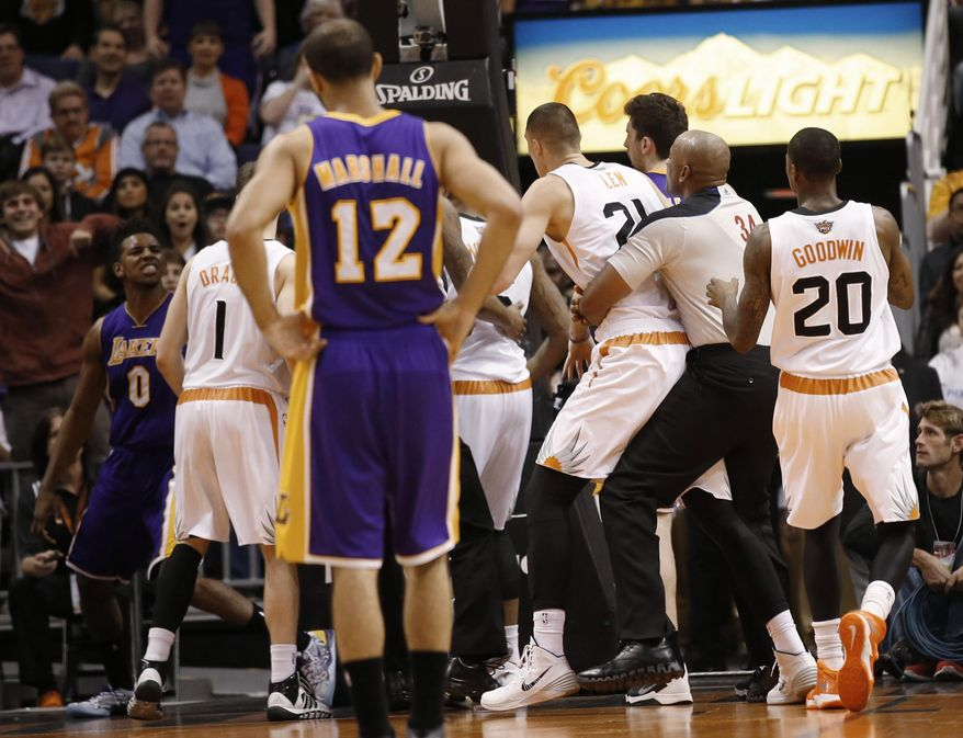 Los Angeles Lakers' Nick Young, left, has words with Phoenix Suns guard Goran Dragic (1) after Young was fouled by Suns' Alex Len during the second quarter of an NBA basketball game Wednesday, Jan. 15, 2014, in Phoenix. (AP Photo/The Arizona Republic, Michael Chow) MESA OUT  MARICOPA COUNTY OUT  NO SALES