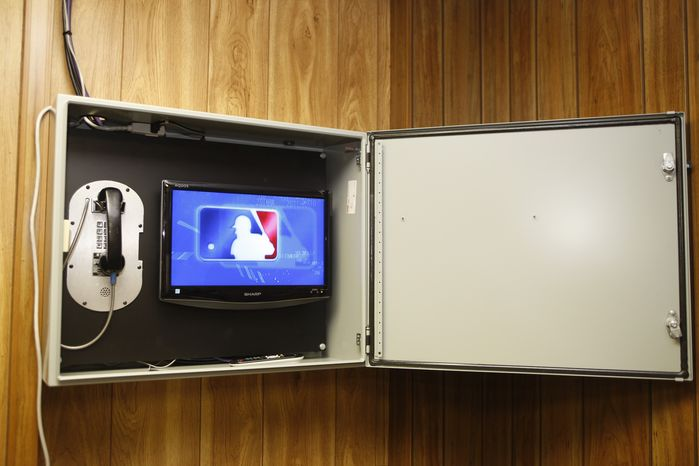 **FILE** This Aug. 28, 2008, file photo shows Major League Baseball's instant replay display shown in the umpires' room before the Chicago Cubs against Philadelphia Phillies baseball game  in