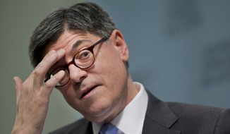 **FILE** Treasury Secretary Jacob Lew pauses while speaking about the U.S. economy, next steps for financial reform, and the Treasury Department's international agenda, Thursday, Jan. 16, 2014, at the Council on Foreign Relations in Washington.  (AP Photo/Manuel Balce Ceneta)