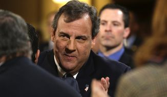 In this Tuesday, Jan. 14, 2014 file photo, New Jersey Gov. Chris Christie arrives to deliver his State Of The State address at the Statehouse in Trenton, N.J. Christie, eager to get on with business amid a scandal over traffic jams that appear to have manufactured by aides, is meeting Thursday morning, Jan. 16, 2014, with homeowners affected by Superstorm Sandy even as the Legislature prepares to issue new subpoenas as part of its investigation. (AP Photo/Julio Cortez, File)