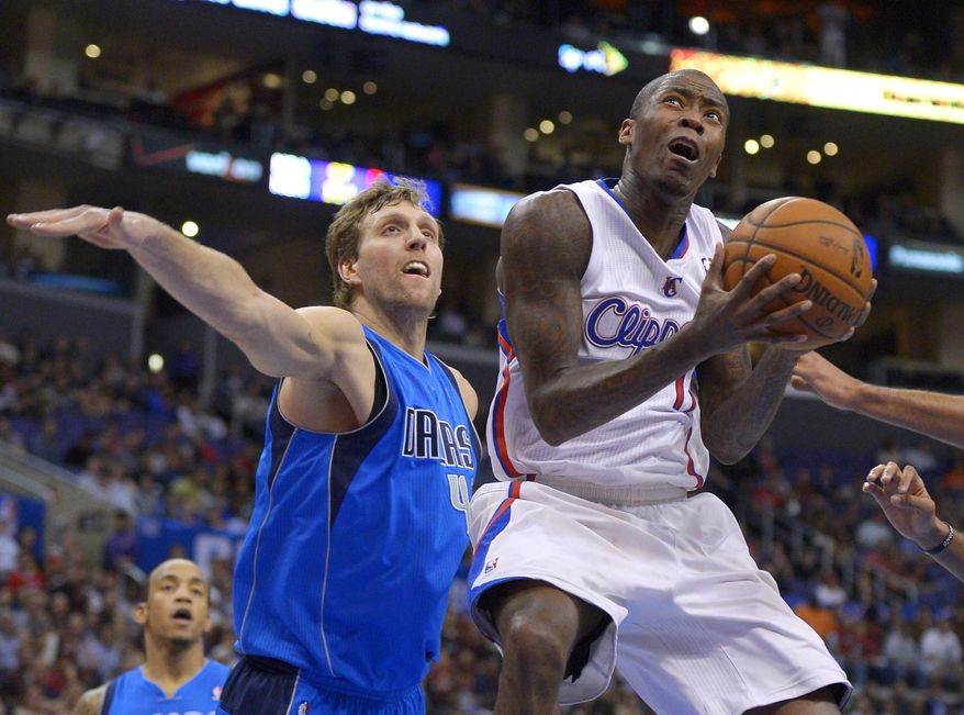 Los Angeles Clippers guard Jamal Crawford, right, puts up a shot as Dallas Mavericks forward Dirk Nowitzki, of Germany, defends during the first half of an NBA basketball game, Wednesday, Jan. 15, 2014, in Los Angeles. (AP Photo/Mark J. Terrill)