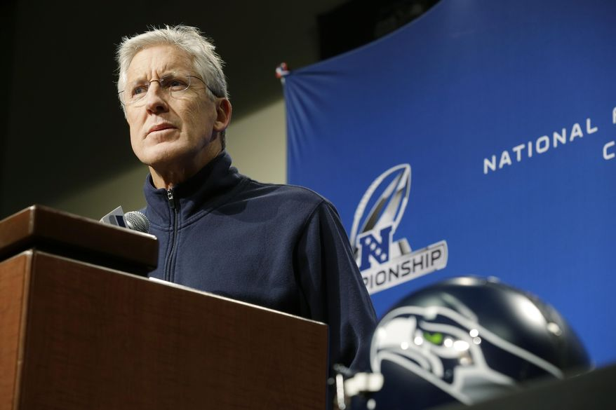Seattle Seahawks head coach Pete Carroll listens to a question as he talks to reporters, Wednesday, Jan. 15, 2014, in Renton, Wash. The Seahawks will play the San Francisco 49ers Sunday in the NFL football NFC championship in Seattle. (AP Photo/Ted S. Warren)
