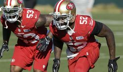 San Francisco 49ers linebacker NaVorro Bowman (53) and linebacker Patrick Willis (52) practice at an NFL football training facility in Santa Clara, Calif., Wednesday, Jan. 15, 2014. The 49ers are scheduled to play the Seattle Seahawks for the NFC Championship on Sunday. (AP Photo/Jeff Chiu)