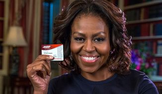 First lady Michelle Obama tweeted a photo of herself Friday holding her new AARP card on her 50th birthday.