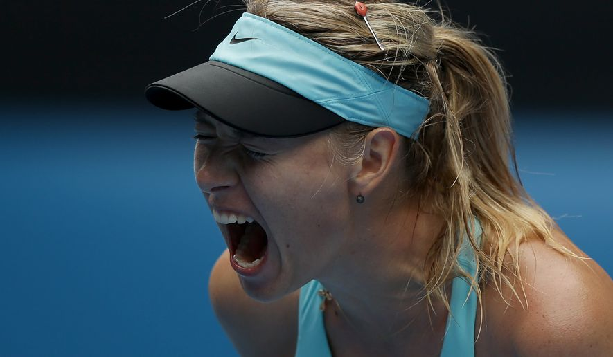 Maria Sharapova of Russia reacts after winning a point against Alize Cornet of France during their third round match at the Australian Open tennis championship in Melbourne, Australia, Saturday, Jan. 18, 2014.(AP Photo/Aaron Favila)