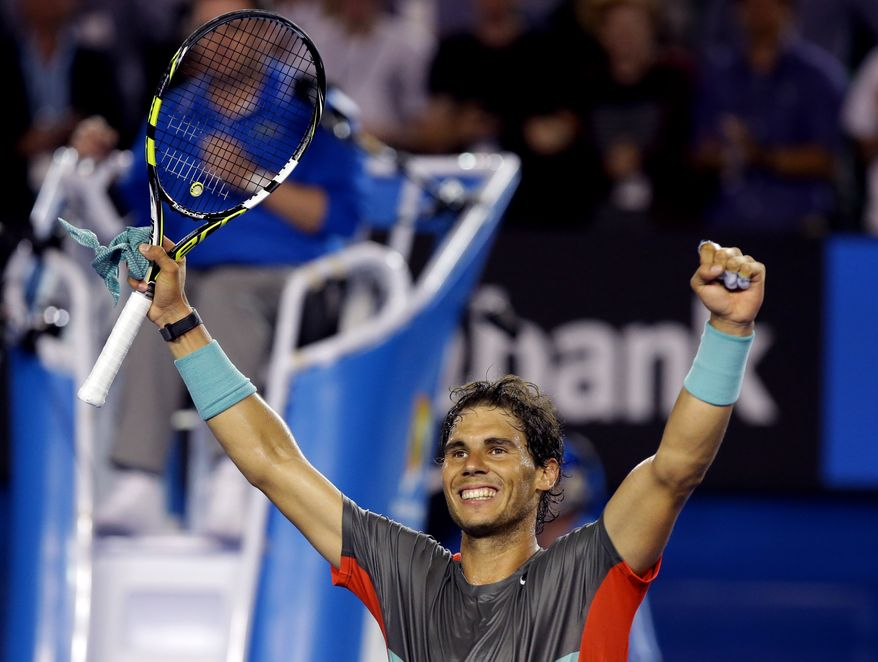 Rafael Nadal of Spain celebrates his win over Gael Monfils of France during their third round match at the Australian Open tennis championship in Melbourne, Australia, Saturday, Jan. 18, 2014.(AP Photo/Aaron Favila)