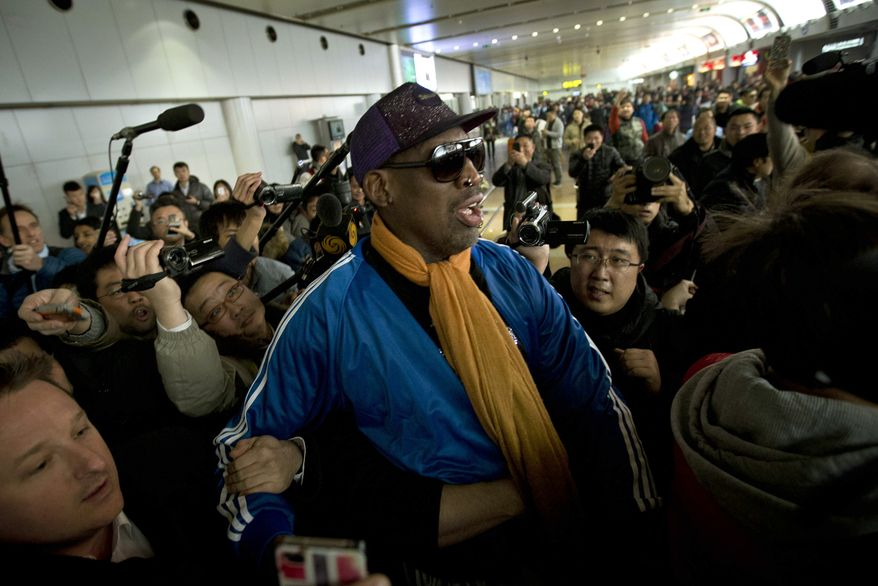 ** FILE ** Former NBA basketball player Dennis Rodman is followed by journalists as he arrives at the Capital International Airport in Beijing from Pyongyang, Monday, Jan. 13, 2014. (AP Photo/Alexander F. Yuan)