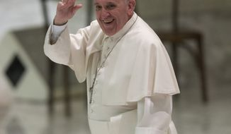 Pope Francis waves as he leaves after an audience with RAI Italian state TV personnel in the Paul VI hall at the Vatican, Saturday, Jan. 18, 2014. (AP Photo/Alessandra Tarantino)