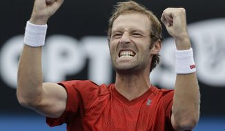 Stephane Robert of France celebrates his win over Martin Klizan of Slovakia during their third round match at the Australian Open tennis championship in Melbourne, Australia, Saturday, Jan. 18, 2014.(AP Photo/Aijaz Rahi)