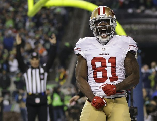 San Francisco 49ers' Anquan Boldin celebrates his touchdown catch during the second half of the NFL football NFC Championship game against the Seattle Seahawks Sunday, Jan. 19, 2014, in Seattle. (AP Photo/Marcio Jose Sanchez)