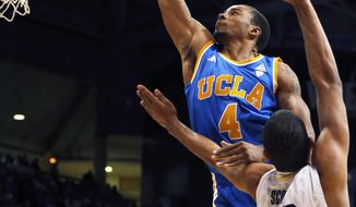 UCLA's Norman Powell shoots as Colorado's Josh Scott defends during the first half of an NCAA college basketball game in Boulder, Colo., Thursday, Jan. 16, 2014. (AP Photo/Brennan Linsley)