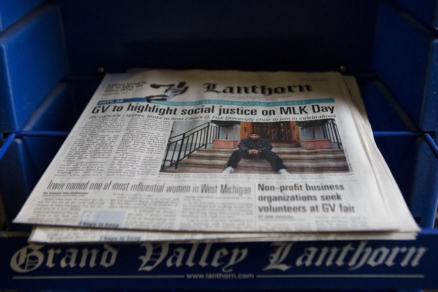 Copies of the Lanthorn sit on a stand in the Kirkhof Center at Grand Valley State University on Friday, Jan. 17, 2014. The student-run newspaper has caused a stir on campus after questioning the university's policy of naming rooms and buildings after donors. (AP Photo/ MLive.com, Lauren Petracca)