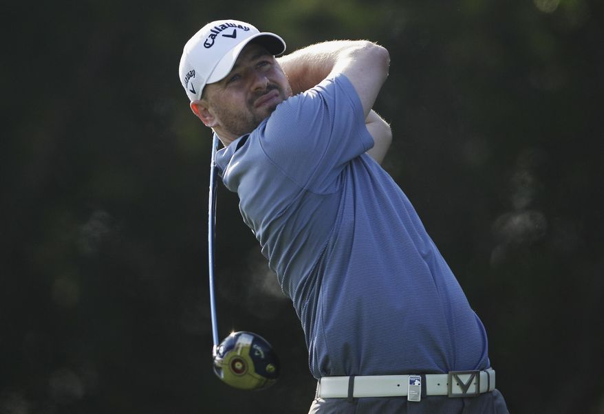 Craig Lee of Scotland tees off on the 5th  hole during the 2nd round of the Abu Dhabi HSBC Golf Championship in Abu Dhabi, United Arab Emirates, Friday, Jan. 17, 2014. (AP Photo/Kamran Jebreili)