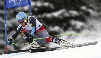 FILE - In this Feb. 6, 2013 file photo, United States' Ted Ligety speeds down the course during the men's super-G, at the Alpine skiing world championships in Schladming, Austria. Ligety won a gold at the 2006 Turin Games, stumbled four years later in Vancouver and then dominated the 2013 world championships. Is he ready to take over an Olympics?  (AP Photo/Alessandro Trovati, File)