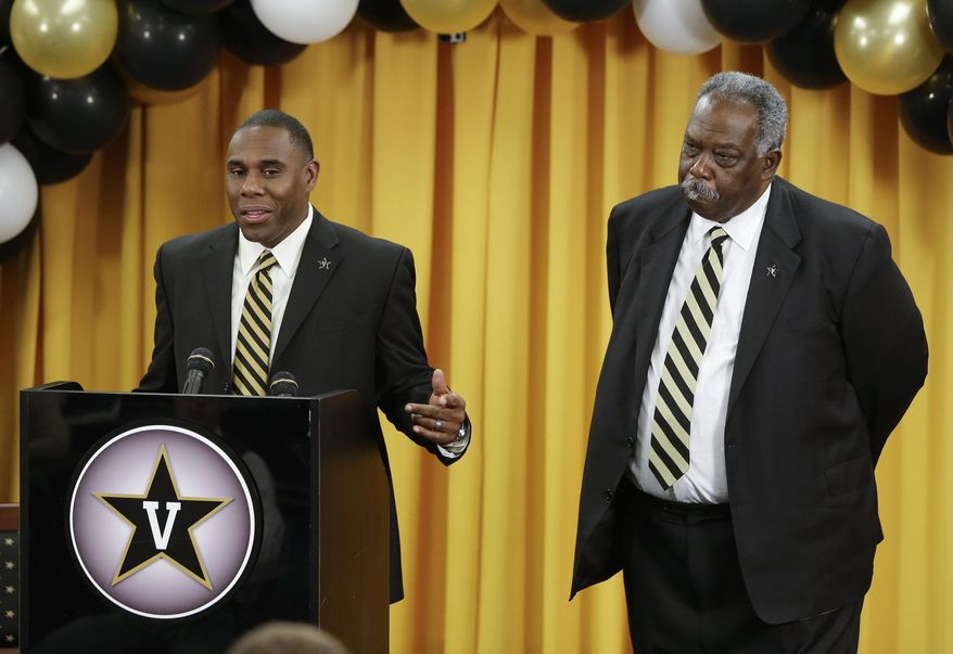 Derek Mason addresses the media as he is introduced as the new Vanderbilt football coach during an NCAA college football news conference Saturday, Jan. 18, 2014, in Nashville, Tenn. Mason was previously the defensive coordinator at Stanford. At right is Vadnerbilt athletic director David Williams. (AP Photo/Mark Humphrey)