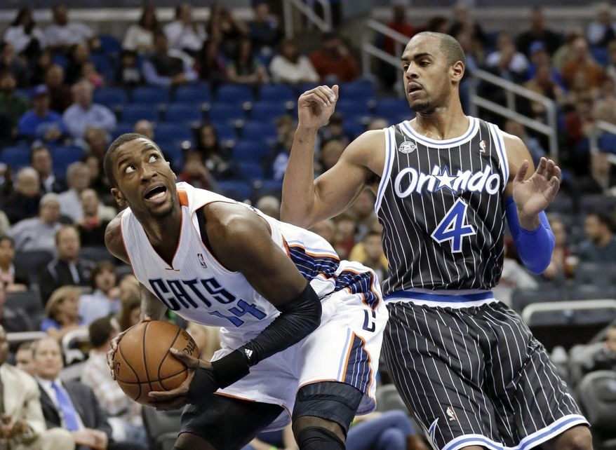 Charlotte Bobcats' Michael Kidd-Gilchrist, left, looks for an open shot as he is guarded by Orlando Magic's Arron Afflalo (4) in the first half of an NBA basketball game in Orlando, Fla., Friday, Jan. 17, 2014. (AP Photo/John Raoux)