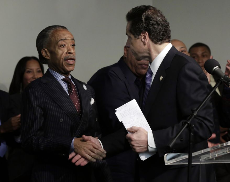 The Rev. Al Sharpton, left, shakes hands with New York Gov. Andrew Cuomo during his appearance at Sharpton's National Action Network headquarters to kick off the Martin Luther King Jr. holiday weekend, in the Manhattan borough of New York, Saturday, Jan. 18, 2014. (AP Photo/Richard Drew)