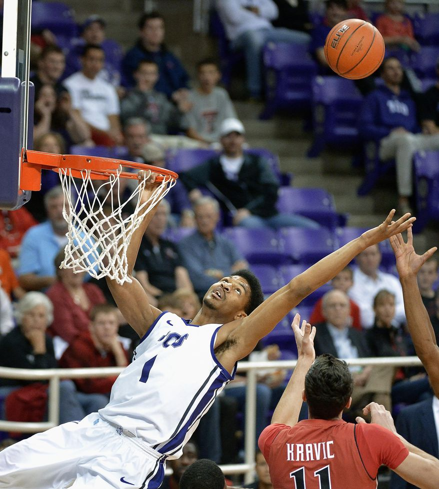 TCU center Karviar Shepherd (1) is unable to sink a dunk and is also called for a technical foul for hanging on to the rim during the first half against Texas Tech during an NCAA college basketball game Saturday, Jan. 18, 2014, in Fort Worth, Texas. Texas Tech won 60-49. (AP Photo/Fort Worth Star-Telegram, Max Faulkner) MAGS OUT (FORT WORTH WEEKLY, 360 WEST); INTERNET OUT