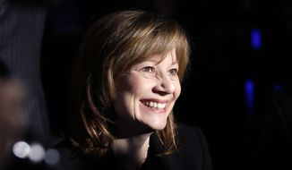 In this Monday, Jan. 13, 2014, file photo shows, incoming General Motors CEO Mary Barra is seen at the awards ceremony for the North Americans Car and Truck of the Year award at the North American International Auto Show in Detroit. General Motors Co. says new CEO Mary Barra will get a base salary of $1.6 million per year as she takes over the global automaker. (AP Photo/Carlos Osorio)