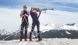 This April 24, 2013 photo shows Tracy Barnes, left, watching her twin sister Lanny Barnes take aim near Molas Pass after a morning workout. The twin Olympic biathletes are training after both recently had surgery to fix compartment syndrome in their legs. (AP Photo/Durango Herald, Shaun Stanley)