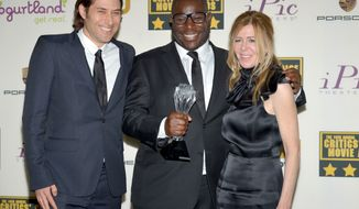 "From left, Jeremy Kleiner, Steve McQueen and Dede Gardner pose in the press room with the award for best picture for ""12 Years a Slave"" poses in the press room at the 19th annual Critics' Choice Movie Awards at the Barker Hangar on Thursday, Jan. 16, 2014, in Santa Monica, Calif. (Photo by John Shearer/Invision/AP)"