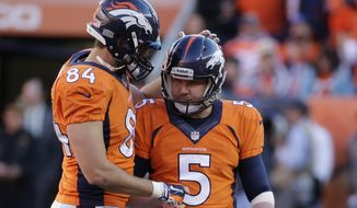 Denver Broncos tight end Jacob Tamme congratulates Denver Broncos kicker Matt Prater (5) on his field goal during the second half of the AFC Championship NFL playoff football game in Denver, Sunday, Jan. 19, 2014. (AP Photo/Charlie Riedel)