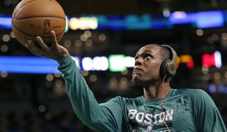 "Boston Celtics guard Rajon Rondo wears headphones as he drives to the basket during a practice before an NBA basketball game against the Los Angeles Lakers, in Boston, Friday, Jan. 17, 2014. Celtics head coach Brad Stevens and general manager Danny Ainge both said Rondo would return for the game  ""barring any setbacks."" (AP Photo/Charles Krupa)"