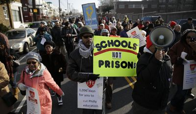 Students, parents and staff who are frustrated with state education funding demonstrate Friday, Jan. 17, 2014, as they march to Central High School in Philadelphia ahead of a scheduled visit by Gov. Corbett. Corbett canceled his first visit as governor to a district-run public school in Philadelphia just before dozens of protesters had come to greet him. Corbett instead held a news conference Friday at his downtown Philadelphia office, and said he hadn't wanted to create a distraction for students at Central High School. (AP Photo/Matt Rourke)