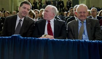 From left, FBI Director James Comey, CIA Director John Brennan, and Director of National Intelligence James Clapper sit together in the front row before President Barack Obama spoke about National Security Agency (NSA) surveillance, Friday, Jan. 17, 2014, at the Justice Department in Washington. The president called for ending the government's control of phone data from millions of Americans. (AP Photo/Carolyn Kaster)