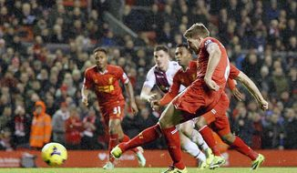 Liverpool's Steven Gerrard scores their second goal of the game from the penalty spot, during their English Premier League soccer match against Aston Villa at Anfield, Liverpool, England, Saturday, Jan. 18, 2014. (AP Photo/Peter Byrne, PA Wire)   UNITED KINGDOM OUT  -  NO SALES  -  NO ARCHIVES