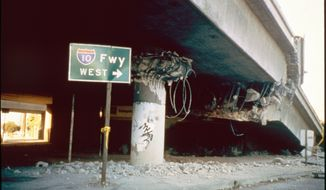 FILE  - This January 1994 file photo, provided by the Civil and Environmental Engineering Department at the University of California, Los Angeles, shows a collapsed freeway support pylon at the La Cienega Boulevard overpass following the Northridge earthquake in Los Angeles.  The Jan. 17, 1994 Northridge earthquake caused death and destruction over a wide area of Southern California. While the state has made strides in retrofitting freeways and hospitals, work remains to strengthen concrete buildings and housing with underground parking.  (AP Photo/UCLA Civil and Environmental Engineering Dept.)
