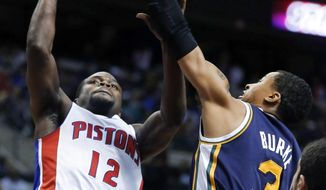 Detroit Pistons guard Will Bynum (12) takes a shot against Utah Jazz guard Trey Burke (3) during the first half of an NBA basketball game Friday, Jan. 17, 2014, in Auburn Hills, Mich. (AP Photo/Duane Burleson)