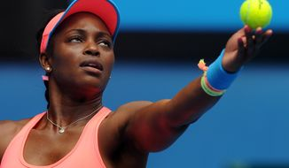 Sloane Stephens of the U.S. servers to Elina Svitolina of the Ukraine during their third round match at the Australian Open tennis championship in Melbourne, Australia, Saturday, Jan. 18, 2014. (AP Photo/Andrew Brownbill)