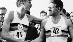 FILE - This is a May 6, 1954, file photo of Roger Bannister, left, who ended the quest for the four-minute mile, with a time of 3:59.4 at Oxford, England is congratulated by pacemaker Christopher Chataway. Chataway, a former 5,000-meter world record-holder who turned to a career in British politics, has died. He was 82.  Chataway, who was knighted by Queen Elizabeth II in 1995, died Sunday Jan. 19, 2014 at a hospice in London after more than two years fighting cancer, son Mark Chataway said. Christopher Chataway, who competed over 5,000 meters at the 1952 and 1956 Olympics, acted as a pacemaker to help Roger Bannister become the first man to break the four-minute mile barrier in 1954.  (AP Photo, File)