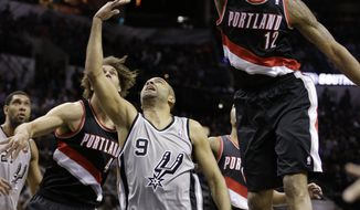 San Antonio Spurs' Tony Parker (9), of France, has his shot blocked by Portland Trail Blazers' LaMarcus Aldridge (12) during the first half on an NBA basketball game, Friday, Jan. 17, 2014, in San Antonio. (AP Photo/Eric Gay)