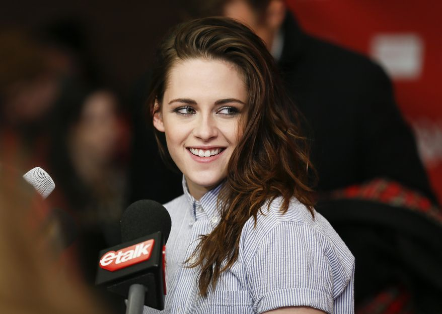 """Cast member Kristen Stewart smiles as she is interviewed at the premiere of the film """"Camp X-Ray"""" during the 2014 Sundance Film Festival, on Friday, Jan. 17, 2014, in Park City, Utah. (Photo by Danny Moloshok/Invision/AP)"""