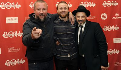 "Cutter Hodierne, center, director of ""Fishing Without Nets,"" poses with executive producers Shane Smith, left, and Eddy Moretti at the premiere of the film at the 2014 Sundance Film Festival on Friday, Jan. 17, 2014, in Park City, Utah. (Photo by Chris Pizzello/Invision/AP)"