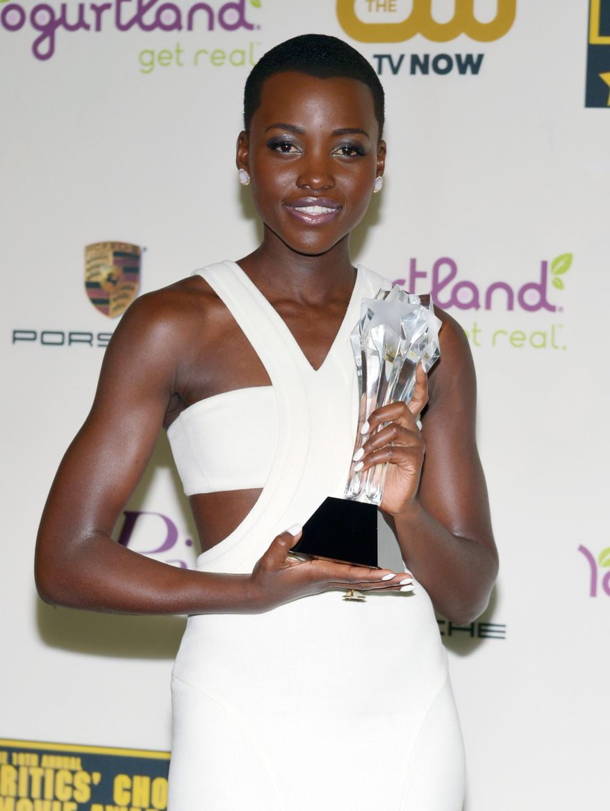 "Lupita Nyong'o poses with the award for best supporting actress for ""12 Years a Slave"" in the press room at the 19th annual Critics' Choice Movie Awards at the Barker Hangar on Thursday, Jan. 16, 2014, in Santa Monica, Calif. (Photo by John Shearer/Invision/AP)"