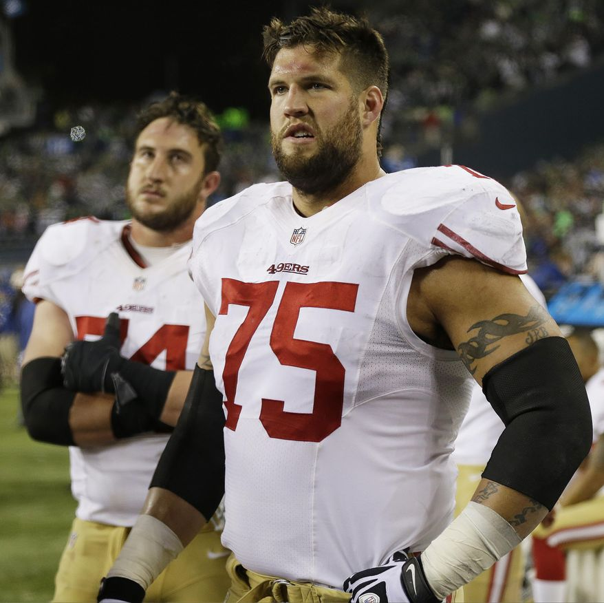 San Francisco 49ers' Alex Boone (75) and Joe Staley watch the field after the NFL football NFC Championship game against the Seattle Seahawks, Sunday, Jan. 19, 2014, in Seattle. The Seahawks won 23-17 to advance to Super Bowl XLVIII. (AP Photo/Marcio Jose Sanchez)