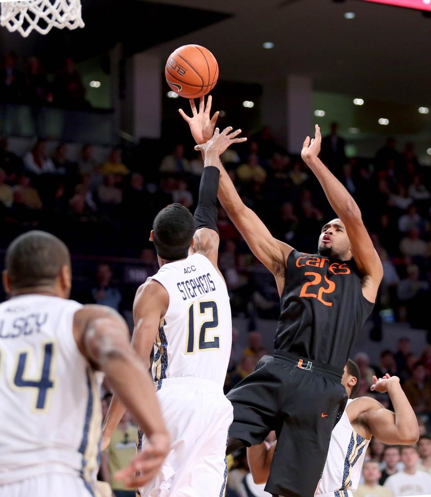 Miami forward Donnavan Kirk (22) attempts a shot as he is fouled by Georgia Tech forward Quinton Stephens in the first half of an NCAA college basketball game, Saturday, Jan. 18, 2014, in Atlanta. Miami defeated Georgia Tech 56-42. Donnavan had 14 points for Miami. (AP Photo/Jason Getz)