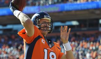 Denver Broncos quarterback Peyton Manning warms up before the AFC Championship NFL playoff football game against the New England Patriots in Denver, Sunday, Jan. 19, 2014. (AP Photo/Jack Dempsey)