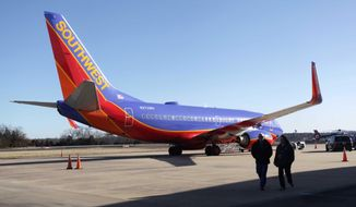 FILE - In this Jan. 13, 2014 file photo, Southwest Airlines Flight 4013 sits at the M. Graham Clark Downtown Airport in Hollister, Mo. The plane was supposed to land at the nearby Branson Airport on Sunday evening, but instead landed at Clark Airport, also known as Taney County Airport, which has a much shorter runway than at Branson, about 7 miles away. The plane's pilots have told investigators they were confused by the small airport's runway lights, believing it to be a larger airport in nearby Branson, the National Transportation Safety Board said Friday, Jan. 17, 2014. (AP Photo/Springfield News-Leader, Valerie Mosley, File)