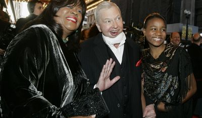 """FILE - In this May 3, 2007 file photo, film critic Roger Ebert, center, his wife Chaz, left, and their granddaughter Raven Evans, arrive for the Chicago premiere of the the Broadway hit """"The Color Purple."""" When """"Life Itself"""" debuts Sunday, Jan. 19, 2014, at the Sundance Film Festival it will be the first time Ebert's wife, Chaz, will see the full documentary about her late husband's life. """"Life Itself"""" includes footage that director Steve James gathered over the final four months before the famed film critic died last April after a long battle with cancer. (AP Photo/Charles Rex Arbogast, File)"""