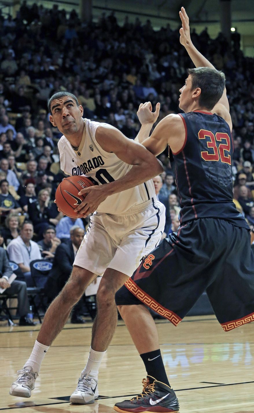 Colorado's Josh Scott looks for a shot as Southern California's Nikola Jovanovic defends during the second half of an NCAA college basketball game in Boulder, Colo., Saturday, Jan. 18, 2014. Colorado won 83-62. (AP Photo/Brennan Linsley)