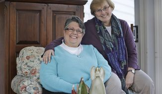 FILE - This Monday Nov. 25, 2013 file photo shows Carol Schall, left, and her partner, Mary Townley, at their home in Richmond, Va.   The couple, who were married in California in 2008, decided to join a lawsuit challenging Virginia's ban on same-sex marriage.  Almost overnight, Virginia has emerged as a critical state in the nationwide fight to grant gay men and women the right to wed. (AP Photo/Steve Helber, File)