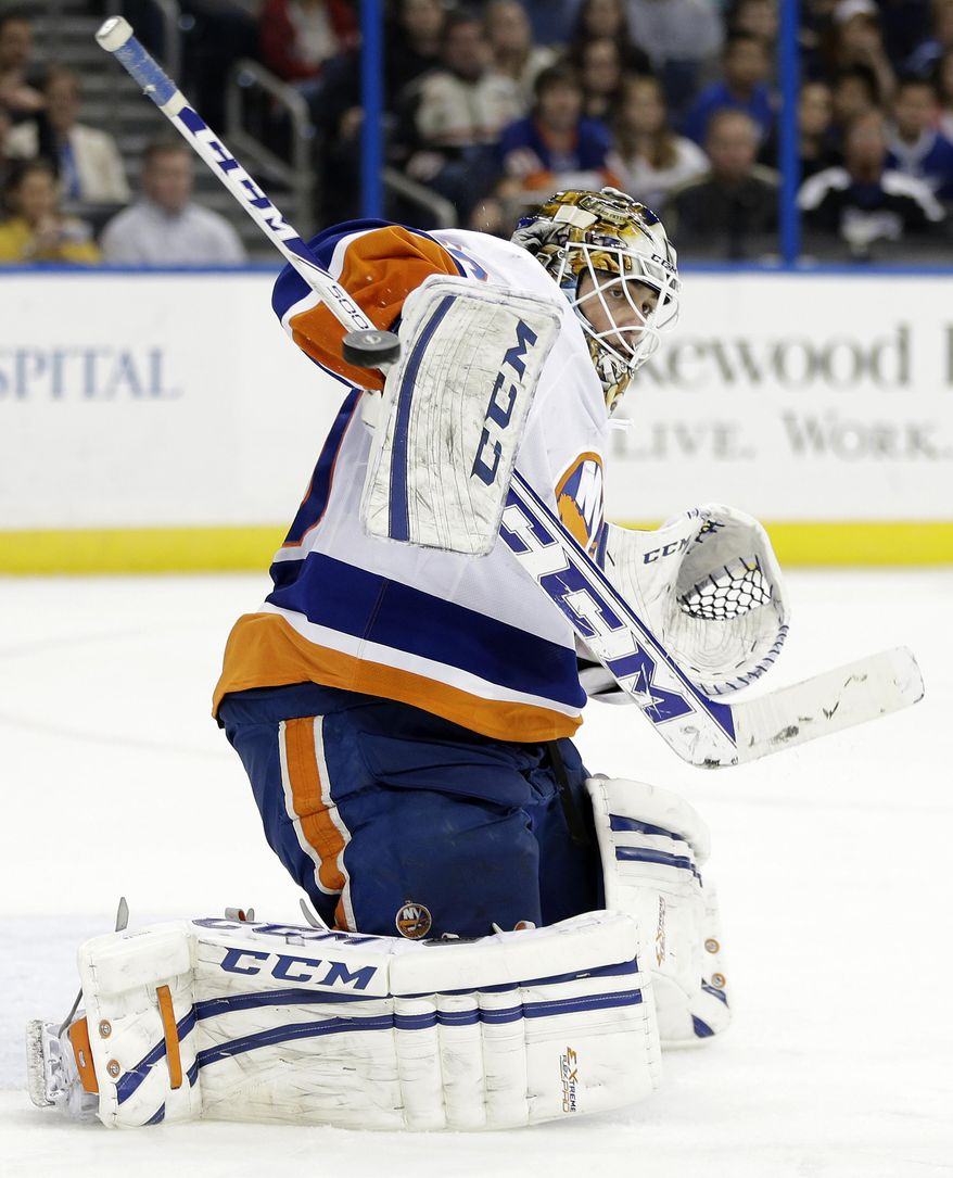 New York Islanders goalie Kevin Poulin (60) makes a blocker save on a shot by the Tampa Bay Lightning during the second period of an NHL hockey game Thursday, Jan. 16, 2014, in Tampa, Fla. (AP Photo/Chris O'Meara)