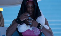 Serena Williams of the U.S. takes a drink during a break in her third round match against Daniela Hantuchova of Slovakia at the Australian Open tennis championship in Melbourne, Australia, Friday, Jan. 17, 2014.(AP Photo/Aaron Favila)