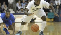 Villanova's Jay Vaughn Pinkston, right, and DePaul's Durrell McDonald scramble for a loose ball in the first half of an NCAA college basketball game onSaturday, Jan. 18, 2014, in Villanova, Pa. (AP Photo/Laurence Kesterson)